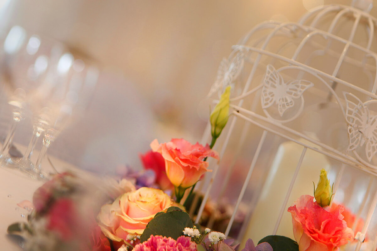 birdcage with flowers wedding